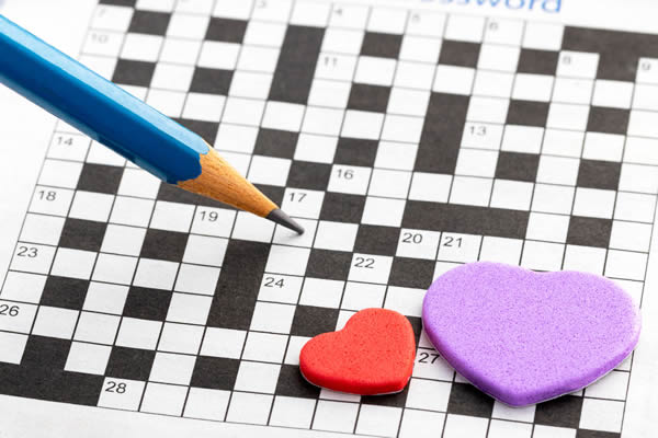 Photo of crossword puzzle with candy hearts.